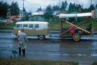 Mango Bus towing a large wood trailer