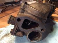 Thermostat to water pump housing surface