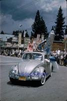 Vintage photo - early sunroof parade Beetle with girl