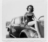 Vintage photo - oval window Beetle with girl posing on hood
