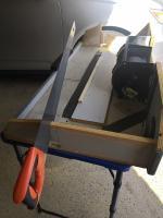 AC tray shelf cut for drain hose