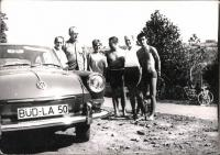 Notchback, with people posing and bikes