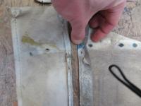 passenger side position of the rear corner rivet hole in the rag-PVC-headliner