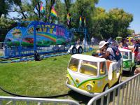 """""""Groovy Bus"""" kiddie split-bus carnival ride at a local event in Richmond, CA"""