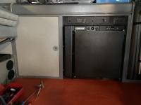 Refrigerator door and trim panel