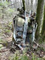 Rusty Bug with iron cross abandoned on local mountain