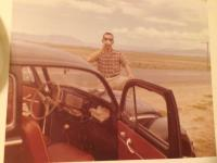 Mr. and Mrs. Mcintyre on their Honeymoon driving a 1956 beetle, 1959