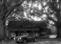 Karmann Ghia with abandoned house