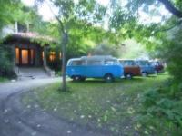 1971 Dormobile and others in front yard 2015