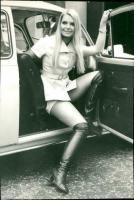 Eva Rueber-Staier in a Volkswagen Beetle