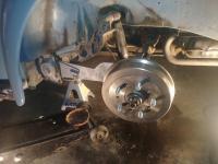 Adjustable rear spring plates
