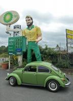 "1977 Beetle at ""Muffler Man"" statue, Elmsford, New York"