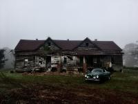 Karmann Ghia with abandoned house in the fog
