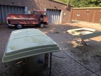 1972 logoed truck doing work