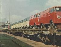 Early pressed bumper Buses loaded on rail cars