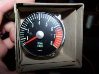 Somebody help me ID this old tach.