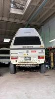 white 2wd highroof with 265/75R16s