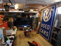 Two old VW dealership VW logo sign faces in my garage