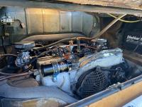 Dual carburetors with evaporative charcoal canister installed