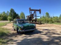 Joann next to an oil rig