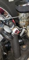 Oil/case breather with dual carbs