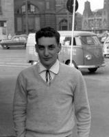 Man posing with early Logo Barndoor Panel in background