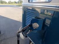 Gas cap holder