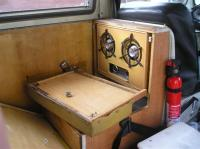 Seatback off showing stove