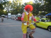 Ronald McDonald on a bicycle