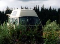 1982 AdventureWagen hiding in brush