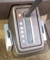 repaired auto trans console with foam sheet slider