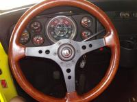 my redone Dino Raid Racemark wood steering wheel