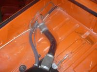 Fuel tank modified hose routing
