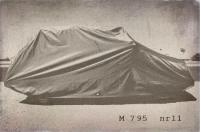 a covered mystery car