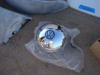 Weird hubcaps in the swap meet
