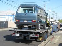 Camper being towed to VW garage for repair