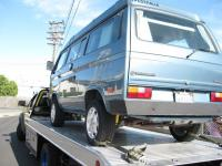 Camper being towed to VW garage for repair