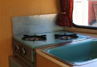 Eriba Puck Stove Area showing Splashguard