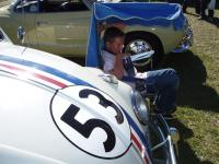 Liam taking a break out of the sun with Herbie.