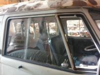 Newly installed passenger-side vent window.
