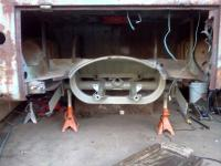 Welding, sanding, rust treating and painting