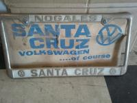 NOS Santa Cruz license frame with dealer placard and bracket
