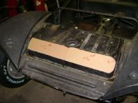 Cut hump from fuel tank for hood clearance