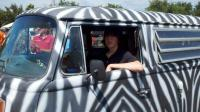 Alex trying out the Zebra Bus for size.